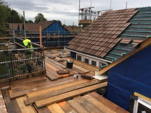 Roof with brand new slates being laid down