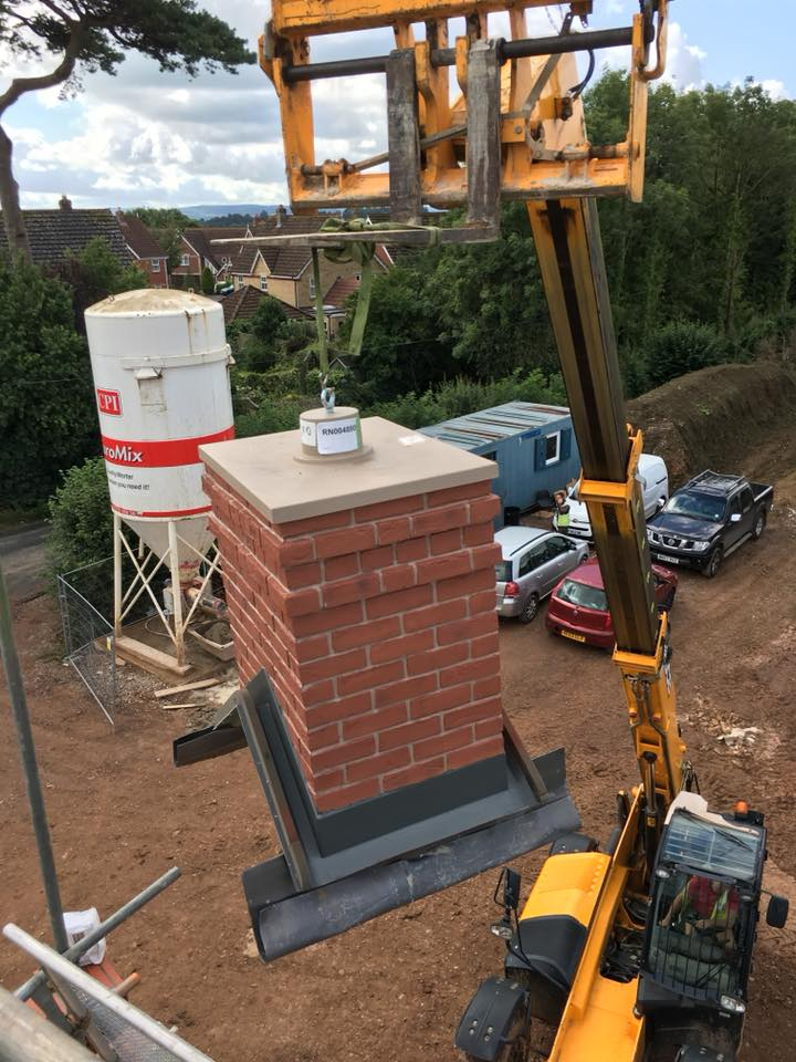 Chimney being lowered on to the roof